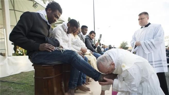 Pope kissing feet